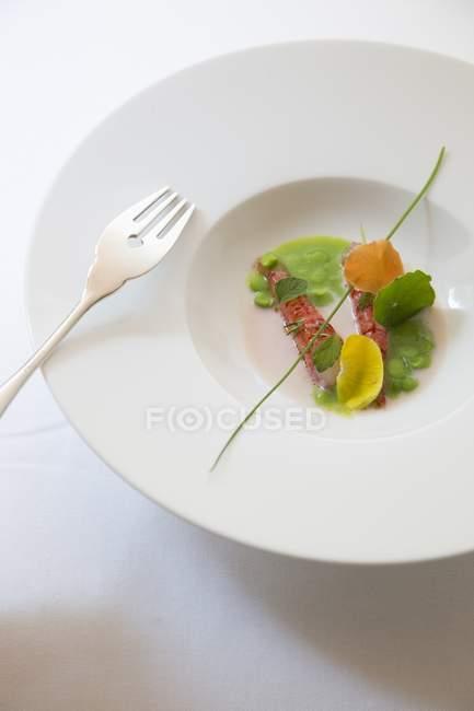Shrimp carpaccio on white plate — Stock Photo