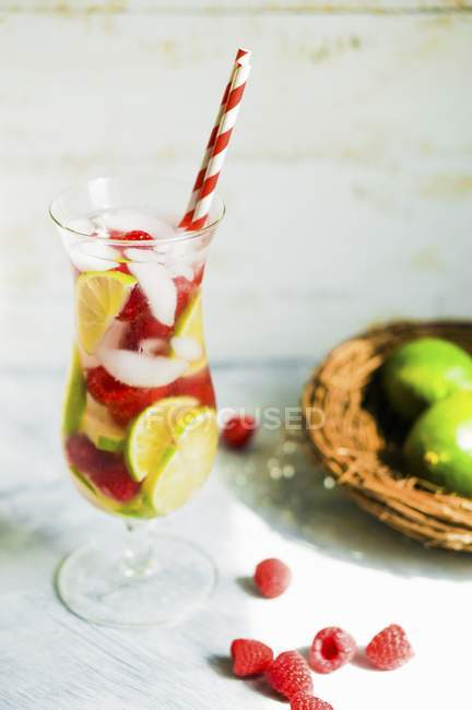 Closeup view of fruity iced tea in a long drink glass with a straw — Stock Photo