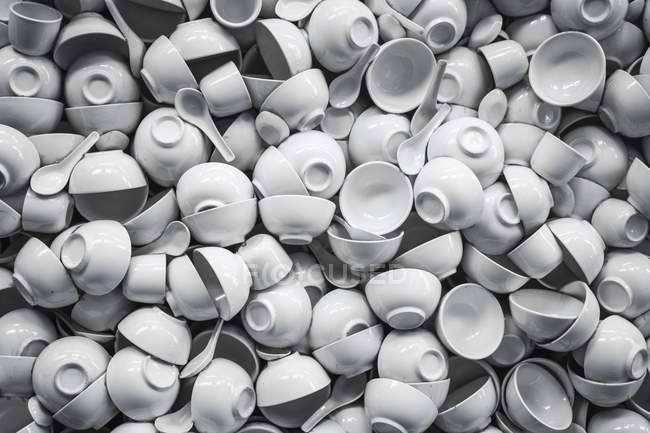 Top view of white porcelain cups, soup bowls and spoons heap — Stock Photo