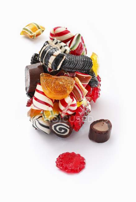 Closeup view of various sweets stuck together on white surface — Stock Photo