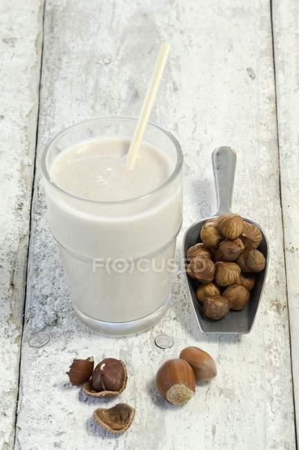 Glass of hazelnut milk — Stock Photo