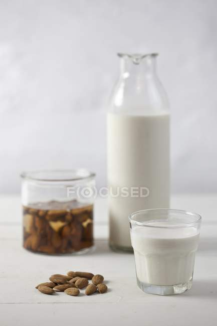 Almonds and almond milk — Stock Photo