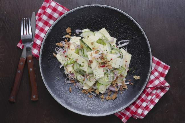 Cheese salad with cucumber — Stock Photo