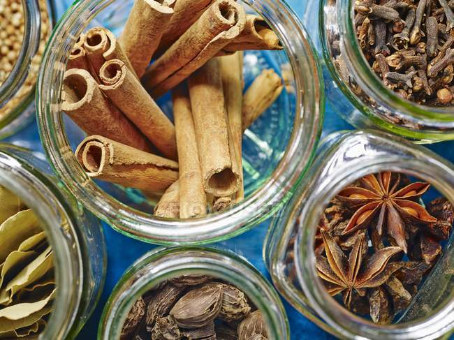 Jars of spices for hot winter drinks — Stock Photo