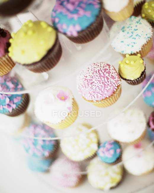 Cupcakes for a wedding on cake stand — Stock Photo | #154659156
