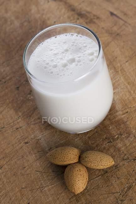 Glass of almond milk — Stock Photo