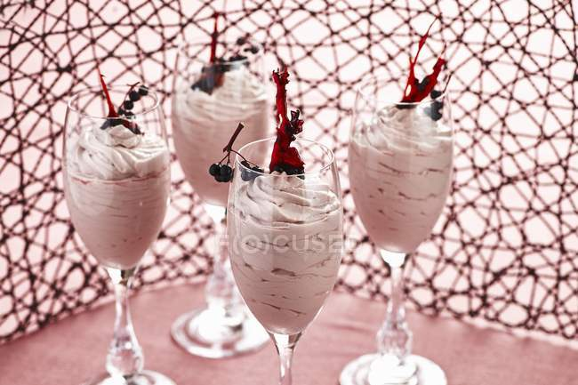 Closeup view of elderberry cream in glasses — Stock Photo