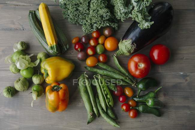 Assorted types of vegetables on a wooden surface — Stock Photo