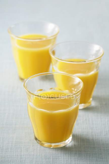 Three glasses of juice — Stock Photo