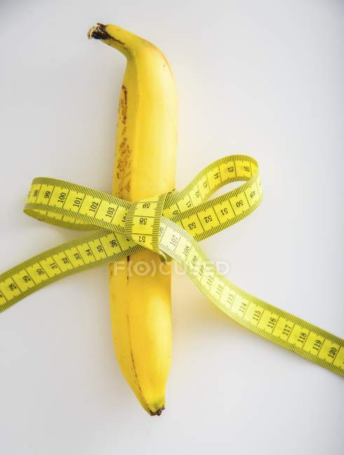 Banana tied with tape — Stock Photo