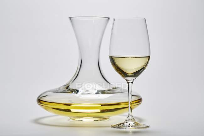 Glass carafe and a glass of white wine — Stock Photo