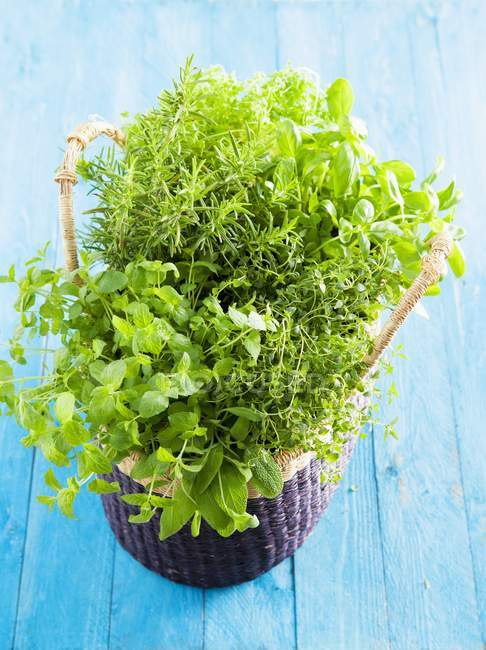 Basket of herbs with mint — Stock Photo