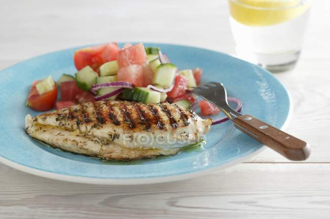 Chicken chop with watermelon and cucumber salad — Stock Photo