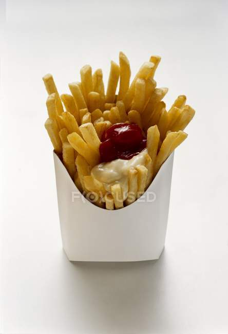 French fries with ketchup and mayonnaise — Stock Photo