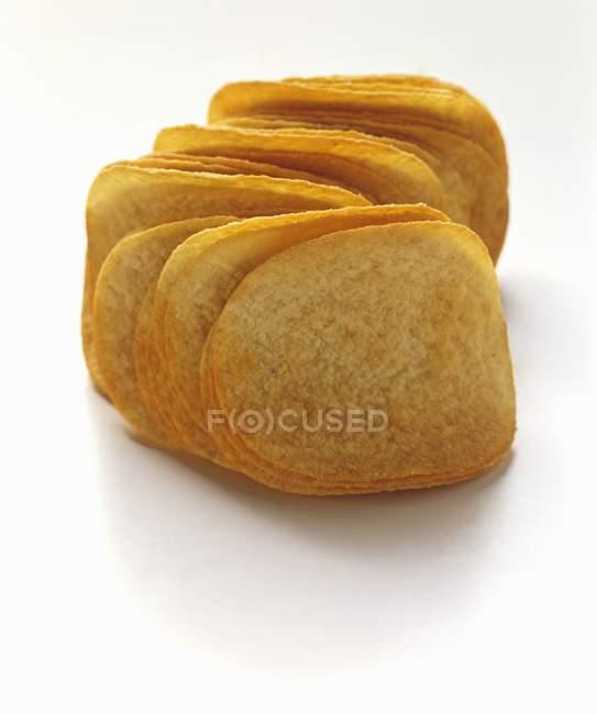Tas de pommes chips — Photo de stock