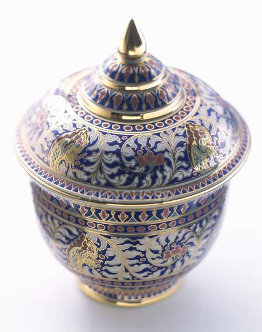 Closeup view of decorative Asian pot with lid on white surface — Stock Photo