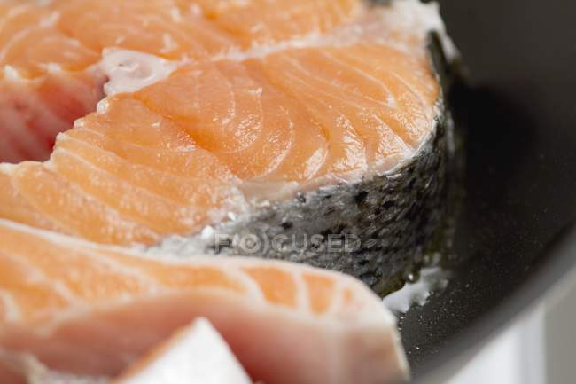 Raw uncooked salmon steaks — Stock Photo