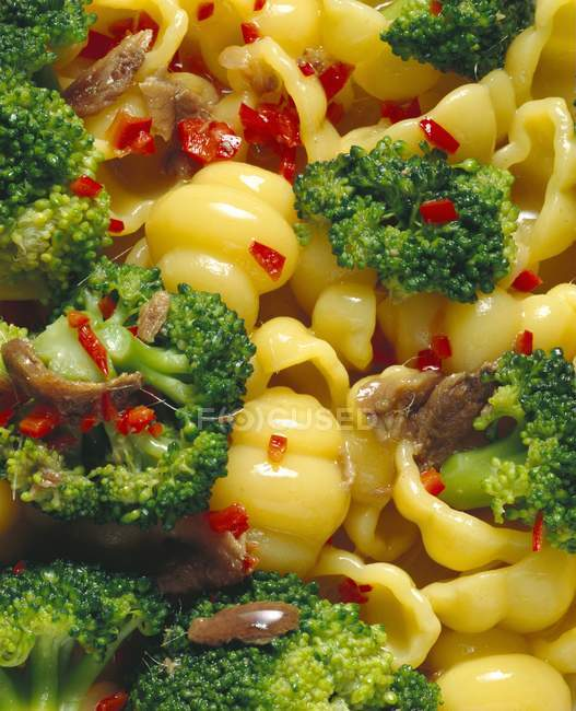 Gnocchi pasta with broccoli and peppers — Stock Photo