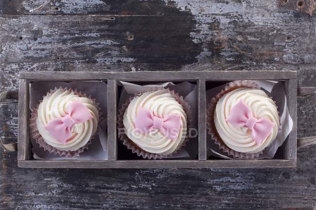 Cupcake with pink fondant — Stock Photo