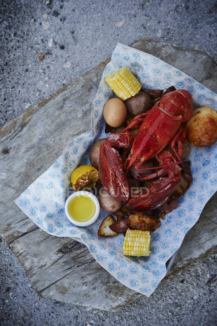 Cooked lobster with corn — Stock Photo