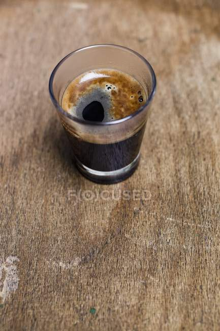 Glass of black coffee — Stock Photo