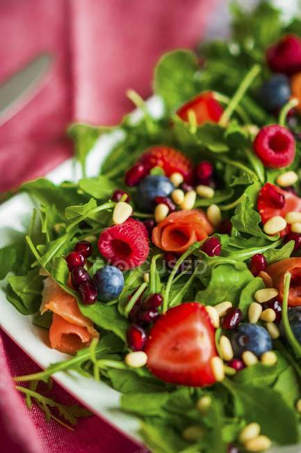 Healthy salad with smoked salmon — Stock Photo