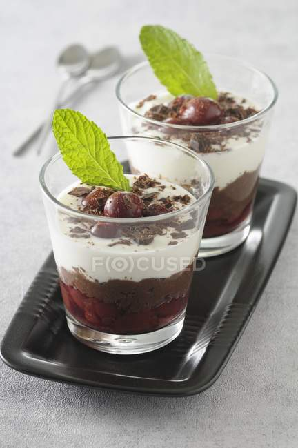 Closeup view of sweet Verrine with cherries and mint leaves — Stock Photo