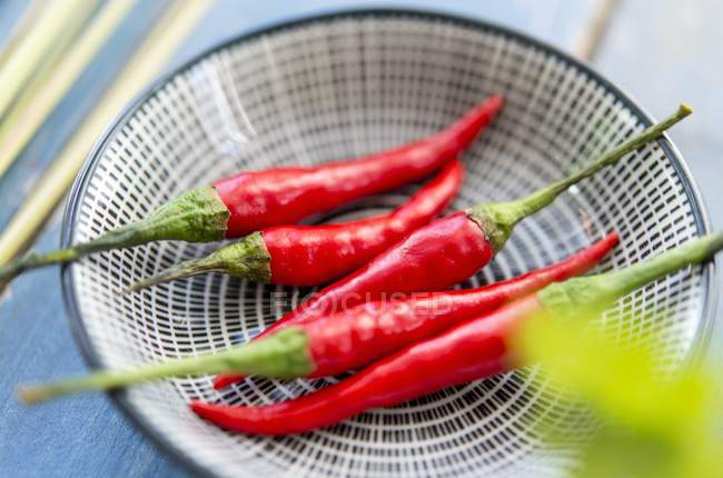 Red chilli peppers on bowl — Stock Photo