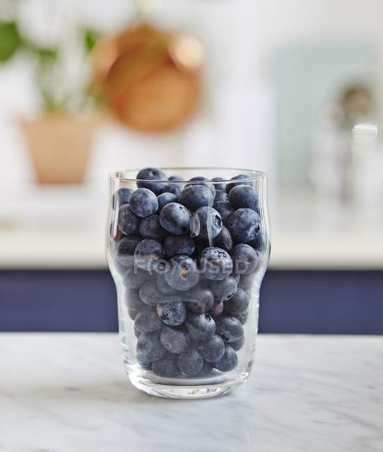 Glass of fresh blueberries — Stock Photo
