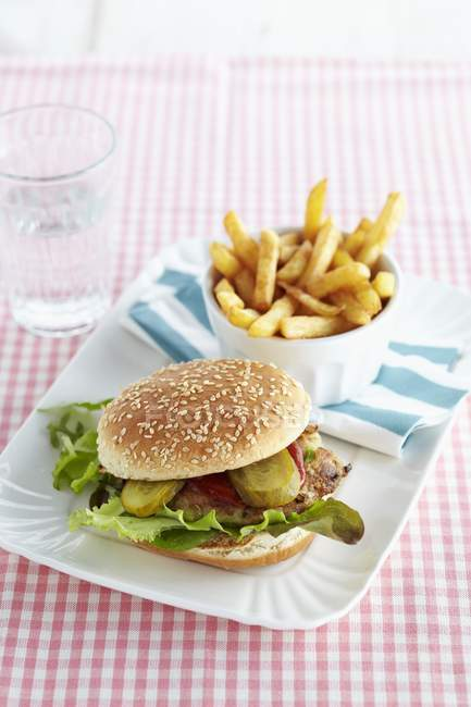 Mackerel burger with chips — Stock Photo