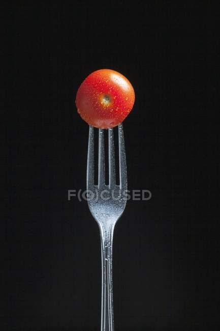 Fresh cherry tomato on fork — Stock Photo