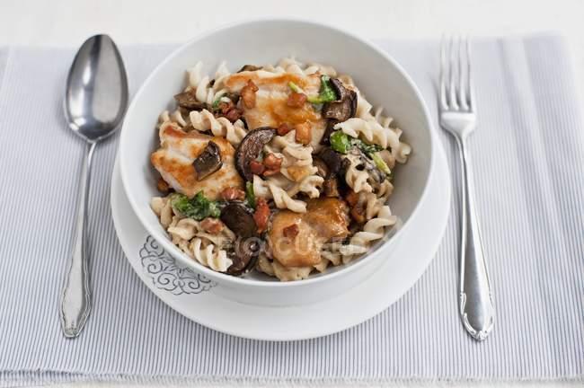 Fusilli pasta with chicken breast — Stock Photo