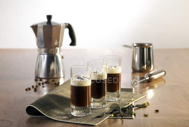 Still life with Espresso shots in glasses — Stock Photo