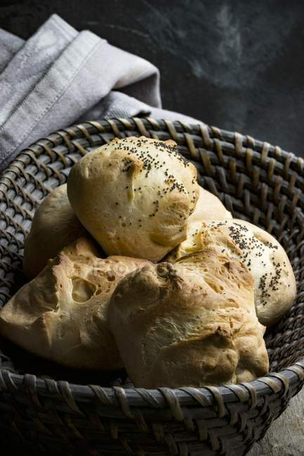 Poppyseed rolls in basket — Stock Photo