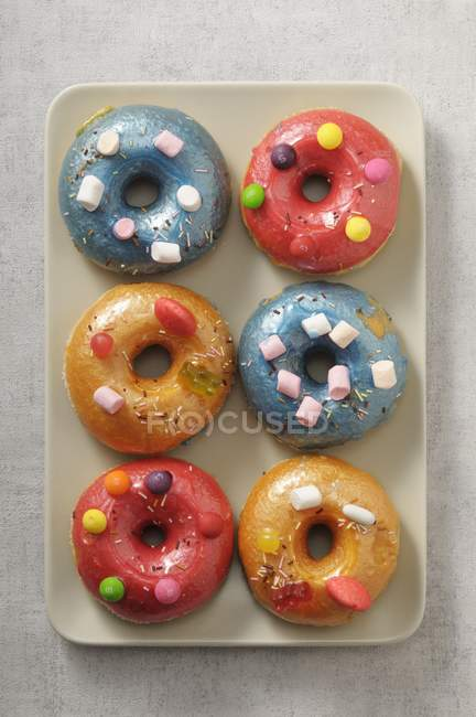 Colourful doughnuts decorated — Stock Photo