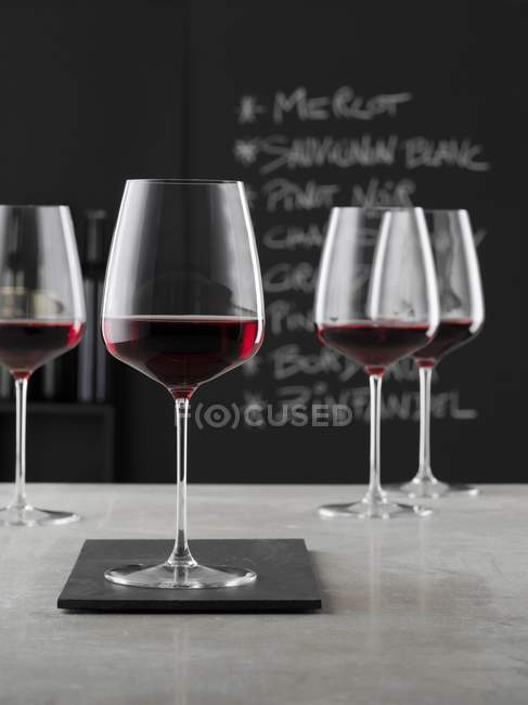 Closeup view of red wine in stemmed glasses — Stock Photo