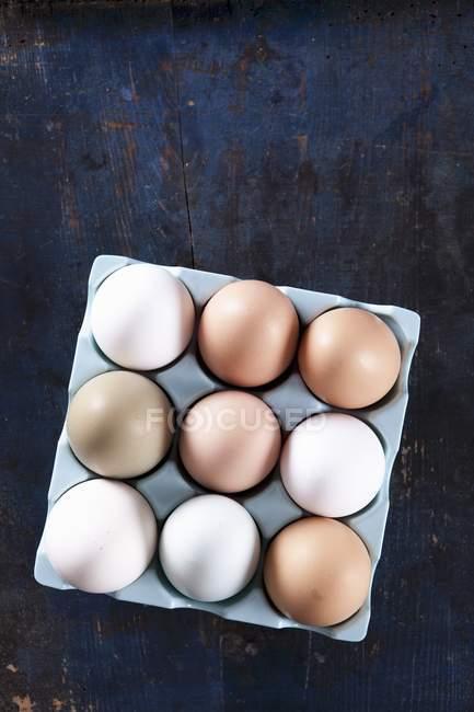 Fresh eggs in a box — Stock Photo