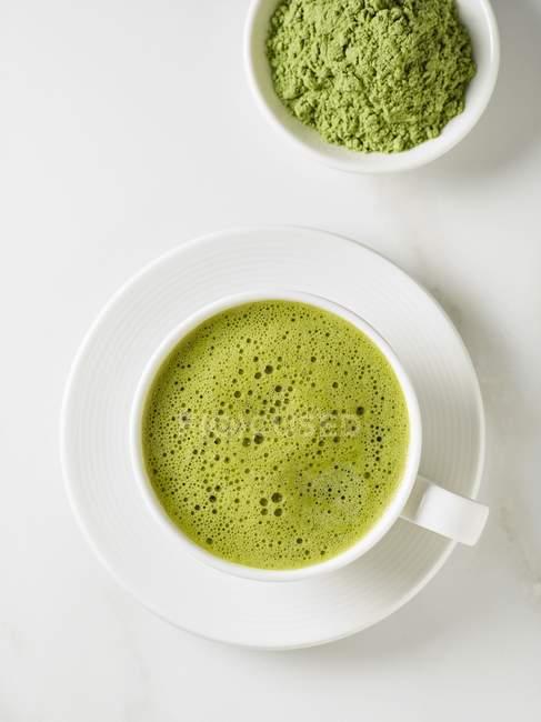 Matcha tea and bowl of tea powder — Stock Photo