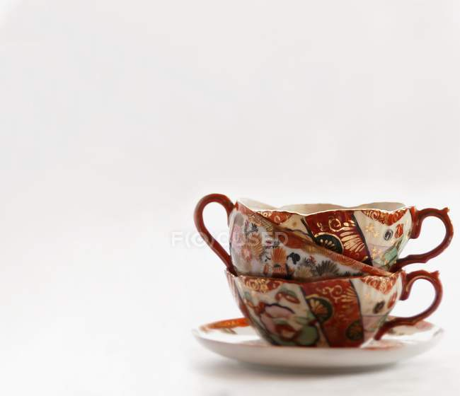 Closeup view of a stack of three vintage porcelain cups — Stock Photo