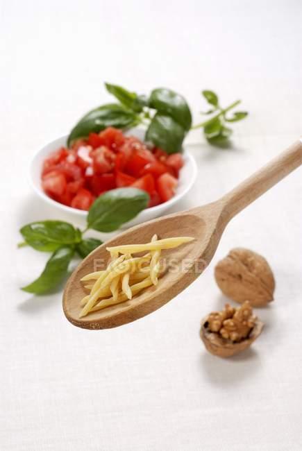 Strozzapreti on wooden spoon — Stock Photo