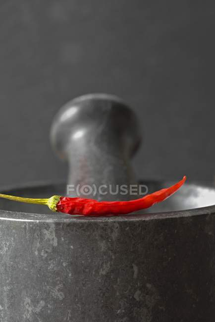 Red chilli pepper on mortar — Stock Photo