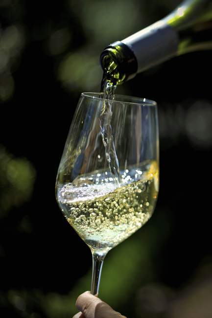 White Wine Pouring from Bottle — Stock Photo