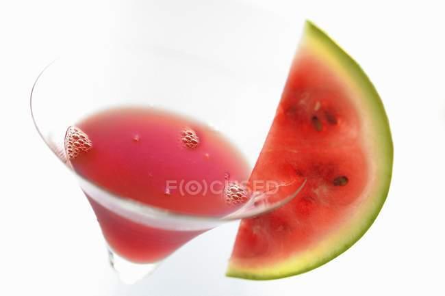 Vue rapprochée de Melon Rouge boisson en verre — Photo de stock