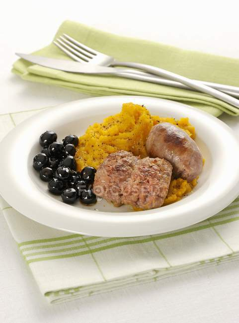 Sausages with mashed pumpkin — Stock Photo