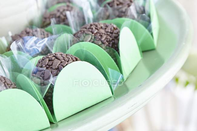 Chocolate truffles in cases — Stock Photo