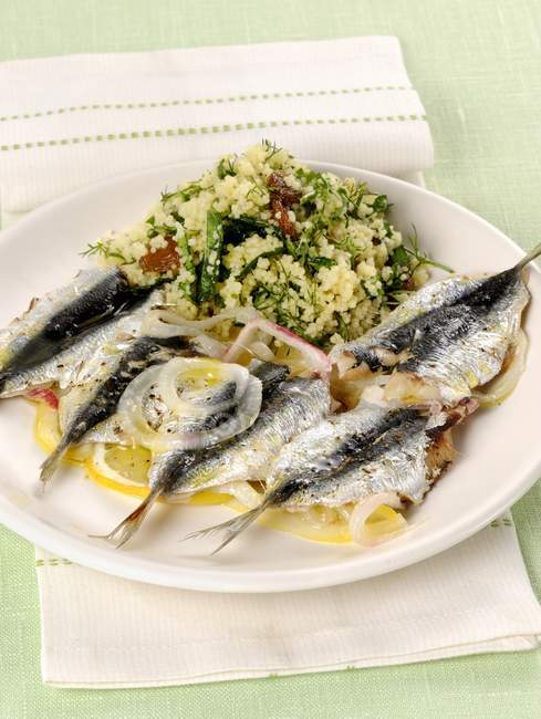Sardines with couscous salad on plate — Stock Photo