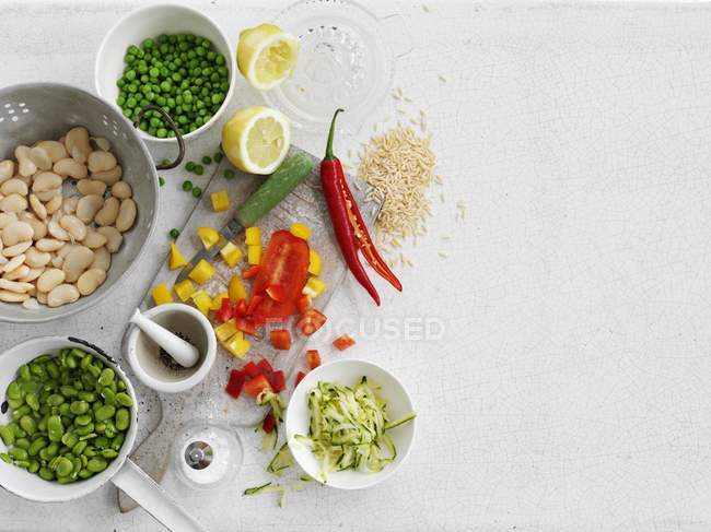 Vegetables, rice, spices and lemons — Stock Photo