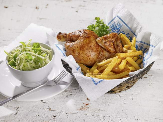 Roast chicken with chips and salad — Stock Photo