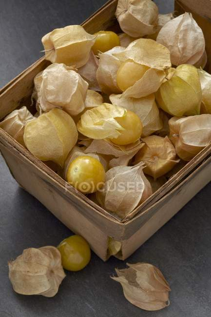 Physalis fruits  in a wooden box — Stock Photo