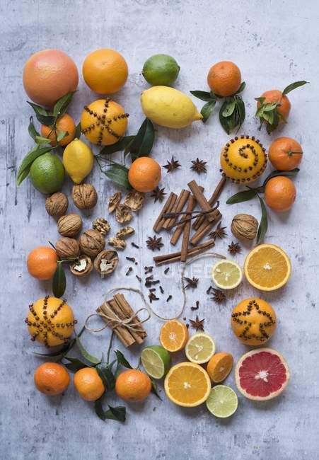 Citrus fruits with nuts and spices — Stock Photo